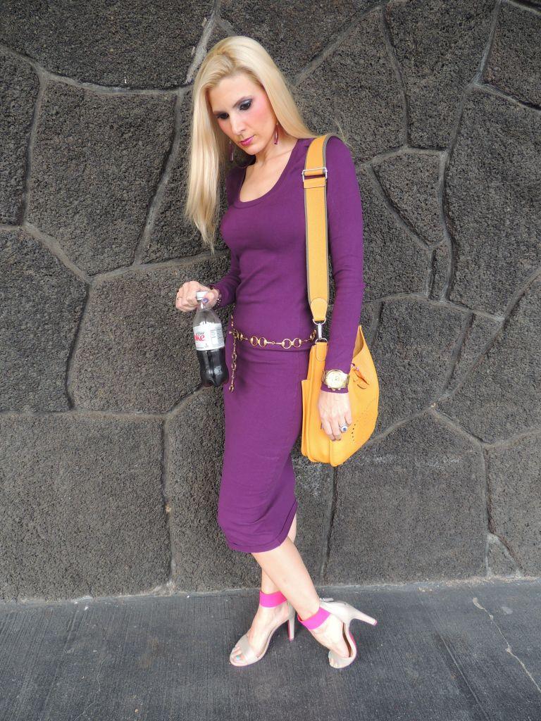 Victorias's Secret Sweater Dress, Nine West Shoes, Michael Kors Watch, Doolittle Jewelry Alexandrite Earrings, Handbeaded Jemstone Bracelets, Horsebit belt, M.A.C. Holiday Pigment Set on eyes, Lip Gloss set on Lips, O.P.I. Nail polish in Iris my Case